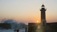 Lighthouse Felgueirasin Porto with waves and sun at sunset - stock footage