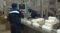 Stacking bales of cotton on the packing tape. Manufacture of medical wadding. Stock Footage