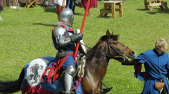 Editorial- Knight Fall off a horse during a historic medieval festival - stock footage