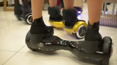 Girl balancing hybrid of the skateboard and the Segway motorized scooter io hawk - stock footage