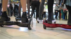 Girls at the Mall balancing Segway motorized scooter io hawk Stock Footage