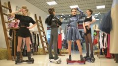 Girls dummy at the Mall balancing Segway motorized scooter io hawk - stock footage