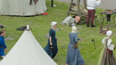 Editorial- Women in medieval knight camp during the historic medieval festival Stock Footage