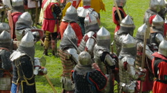 Knights prepare for battle during the historic medieval festival Stock Footage