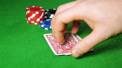 Poker player with pocket ace and king looks at his cards. Stock Footage