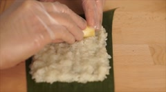 Woman Asian hand making banana cake in glutinous rice Stock Footage