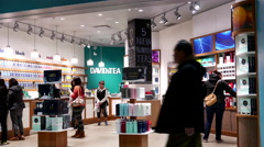 One side of shopper inside Davids tea store Stock Footage