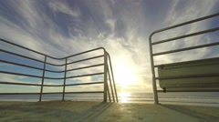 Time lapse of sun setting over Pacific Ocean from atop a Lifeguard Tower in 4k - stock footage