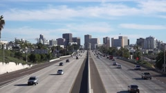 Airplane Flying Above San Diego Freeway - stock footage