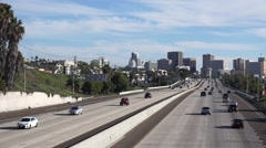 Airplane Flying Above San Diego Freeway Stock Footage