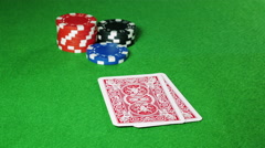 Poker player with pocket pair of queens looks at his cards. Stock Footage
