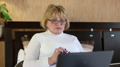 Woman with laptop and cell phone Stock Footage