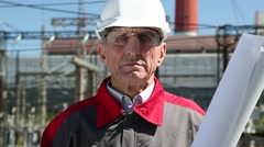 Worker in white hard hat at power station Stock Footage