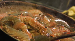 Slow motion of Gambas cooking - stock footage
