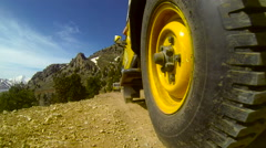 Low angle view of Jeep Safari on mountain road.  Stock Footage