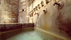 The beautiful bronze faucet for drinking water in the streets of Perugia Stock Footage