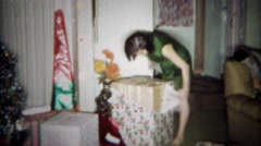 1966: Girl gets giant boxed stuffed animal toy gag gift for Christmas.  BUFFALO, Stock Footage
