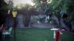 1966: Backyard grotto pool cabana lounging area at residential home. SAN DIEGO, Stock Footage