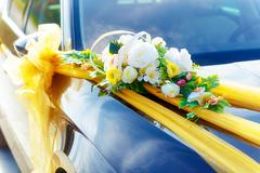 Luxury wedding car decorated with flowers. White flower and ribbons - stock photo