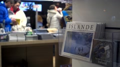 Iceland tour guide book,tourist shopping in iceland Stock Footage