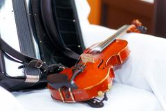 Wedding stillife with violin and accordeon on a white cloth Stock Photos