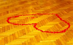 red heart of rose petals on dance parket - love concept - stock photo
