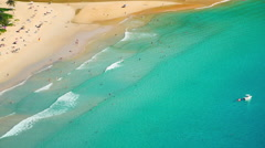Aerial view of people relax and swim on summer vacation on tropical sandy beach Stock Footage