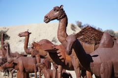 Giant metal animal statues in the desert - stock photo