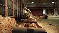 View of profiled bar pulled by machine Stock Footage