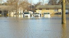 4K utility trucks in flood waters - stock footage