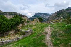 Ruins of fortress walls with views of mountains, Old Bar, Montenegro - stock photo