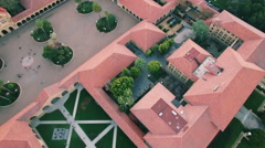 4K Aerial drone shot Stanford University above houses forward Stock Footage