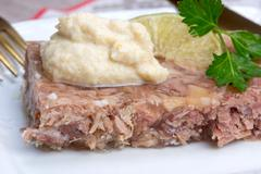 Russian aspic - kholodets with chopped horseradish (chren) Stock Photos