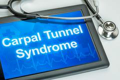 Tablet with the diagnosis Carpal Tunnel Syndrome on the display Stock Photos