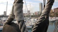 Dolly shot from the ancient ship to Alicante city Stock Footage