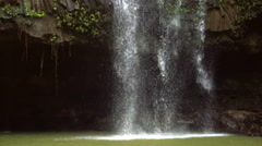 Tropical Waterfall in Lush Green Hawaiian Jungle. Slow Motion - stock footage