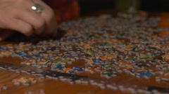 Woman hands sorting puzzle pieces Stock Footage