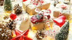 Christmas and New year blurred background with toy car, presents Stock Footage