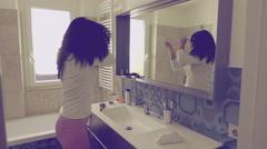 Vintage look of beautiful woman dancing in bathroom slow motion Stock Footage