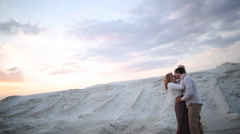 Man and woman are kissing on sand quarry Stock Footage