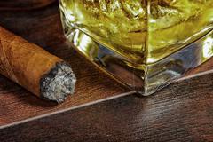 Whiskey and a cigar Stock Photos