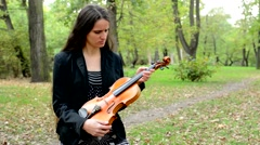 Young attractive displeased woman hold violin and shake with head  Stock Footage