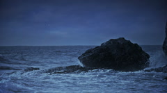 Night sea view with waves crashing at rocks. Stock Footage