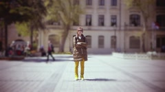 SLOW MOTION: young woman stands at the street in the centre of Istanbul city. - stock footage