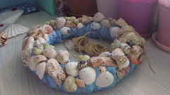 Stock Video Footage of Bonding seashells on decorative wreath. Hand made