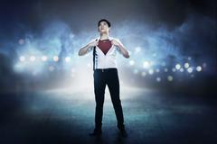 Asian business man open shirt like super hero Stock Photos