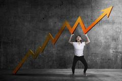 Business woman raise up sales chart so its ascending Stock Photos
