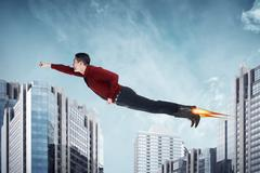 Asian business man flying with rocket on the shoes Stock Photos
