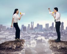 Asian business man and woman shout each other Stock Photos