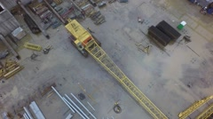 tower crane builds the building of the shopping mall in Russia shot on copter - stock footage